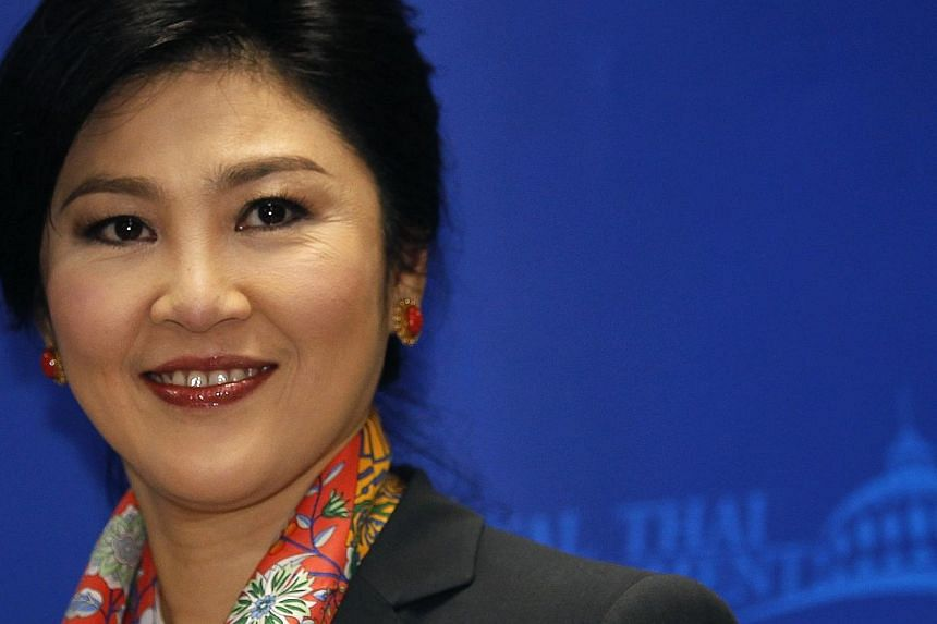 Thailand's deposed former prime minister Yingluck Shinawatra on Friday, July 18, 2014, ruled out going into self-exile to avoid possible criminal charges, after the country's junta gave her permission to travel overseas. -- PHOTO: REUTERS
