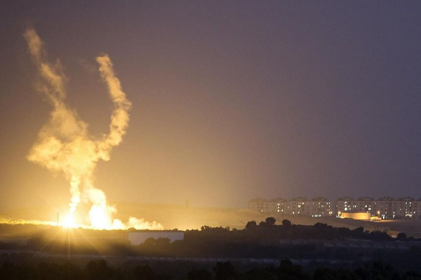 An Israeli rocket is fired into the northern Gaza Strip on July 17, 2014. Israeli Prime Minister Benjamin Netanyahu on Thursday instructed the military to begin a ground offensive in Gaza, an official statement from his office said. -- PHOTO: REUTERS