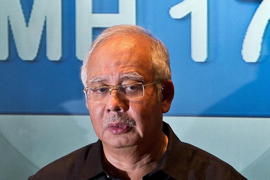 Malaysia's Prime Minister Najib Razak addresses a press conference at a hotel in Sepang, ouside Kuala Lumpur on July 18, 2014, after Malaysia Airlines flight MH17 carrying 298 people from Amsterdam to Kuala Lumpur crashed in eastern Ukraine. -- PHOTO