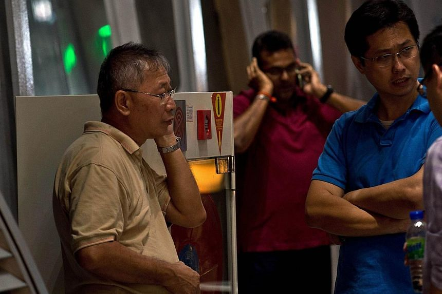 Relatives of passengers onboard Malaysia Airlines flight MH17 from Amsterdam wait for information outside the family holding area at the Kuala Lumpur International Airport in Sepang on July 18, 2014. -- PHOTO: AFP