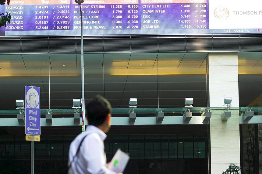 The Singapore stock market was 0.3 per cent weaker at 3,296.82 points in mid-morning trading. -- PHOTO: ST FILE