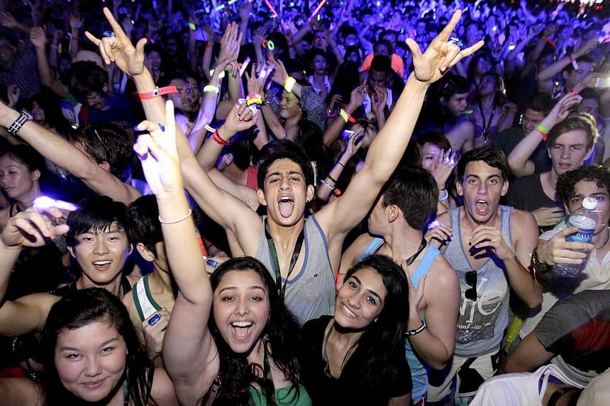 Partygoers at ZoukOut 2013. Singapore's biggest annual outdoor dance music festival will have its final run this year if Zouk, the nightclub behind the event, is forced to close by the end of the year.-- PHOTO: ST FILE