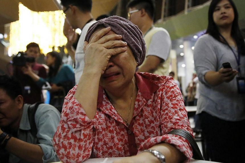 A woman, who said she believed her sister was on Malaysia Airlines flight MH17, cries as she waits for more information about the crashed plane at Kuala Lumpur International Airport in Sepang July 18, 2014. -- PHOTO: REUTERS