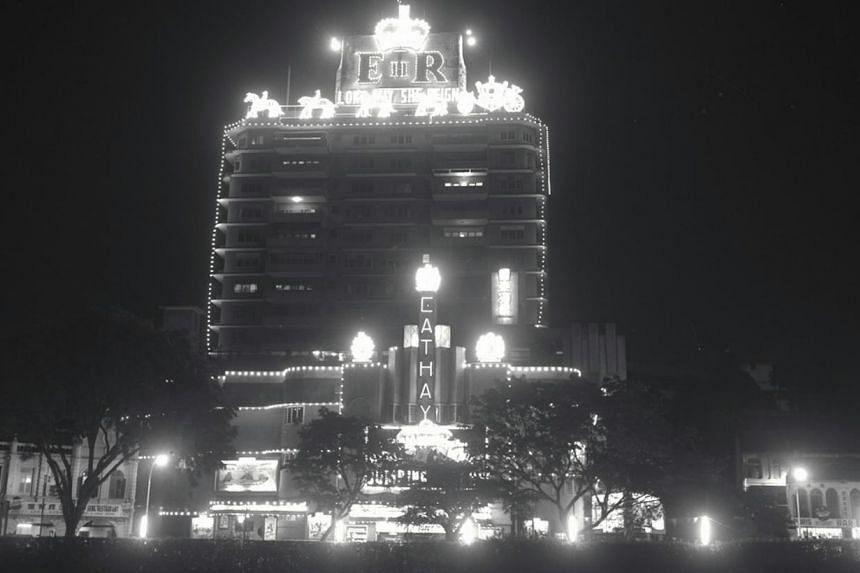 Cathay Building is seen here decorated with lights to celebrate a royal event in colonial Singapore. -- PHOTO: ST FILE