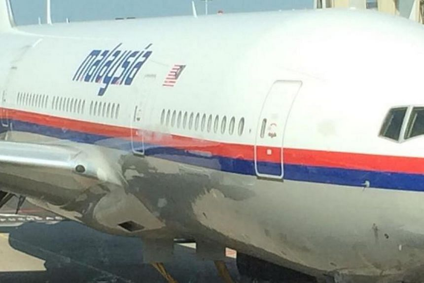 """A pictureof what appears to be the downedMalaysia Airlines flight MH17 taken byyoung DutchmanCor Panminutes before he boarded the plane. He posted the picture on his Facebook page with caption,""""If it should disappe"""