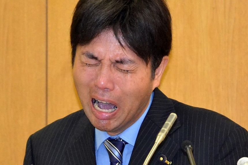 Japanese provincial politician Ryutaro Nonomura crying at a press conference to explain his profligate use of public funds at a prefectural office in Kobe in Hyogo prefecture, western Japan on July 1, 2014.The Japanese police on Friday, July 18