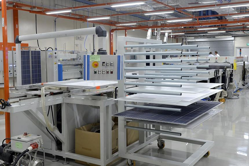 The Solar Energy Research Institute of Singapore opened the only full-scale solar-module testing and development facility in South-east Asia on Friday, July 18, 2014. -- ST PHOTO:DESMOND FOO