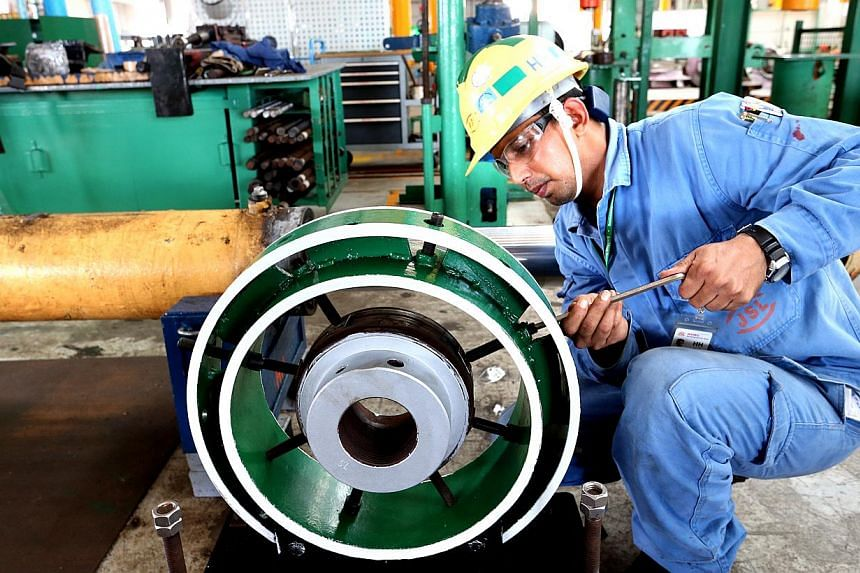 Assistant technical engineer Shamimul Islam Md Rezaul Karim working with a c-dile machine, which allows for safer maintenance on piston heads. The Manpower Ministry will review the existing Code of Practice on workplace safety and health ri