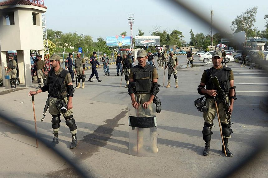 Pakistani Rangers stand guard at the Benazir Bhutto International Airport in Islamabad on June 23, 2014.A United States citizen was arrested at Islamabad airport on Friday, July 18, 2014 for attempting to board a plane carrying ammunition, Paki