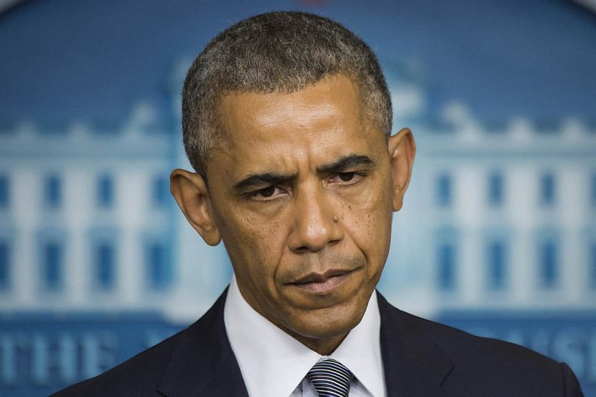 US President Barack Obama makes a statement on Ukraine from the Brady Press Briefing Room at the White House in Washington, DC, July 18, 2014. President Obama said that the Malaysia plane downing was an 'unspeakable' tragedy. -- PHOTO: AFP