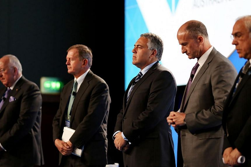 (From left) Rio Tinto CEO Sam Walsh, SEB Chairman Marcus Wallenberg, Treasurer of Australia Joe Hockey, GE Global Growth and Operations CEO John Rice and OECD Secretary-General Angel Gurria hold a minute silence for the victims of Malaysia Airlines f