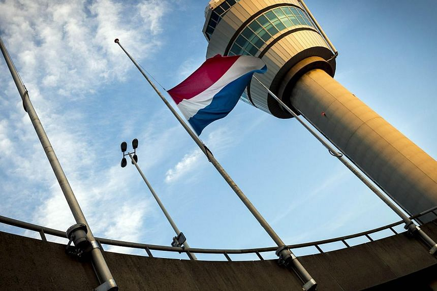 A Dutch flag is flown at half-mast at the Schiphol Airport near Amsterdam, on July 18, 2014.Interpol on Friday said it will send a team in the next 48 hours to help identify victims killed by the Malaysia Airlines flight MH17 crash in east Ukra