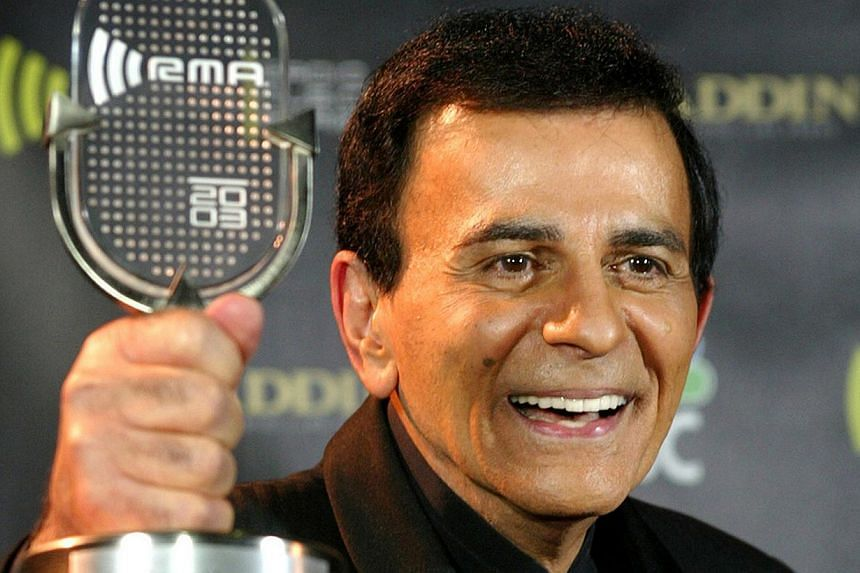 Casey Kasem poses with his Radio Icon Award at the 2003 Radio Music Awards, at the Aladdin Theatre for the Performing Arts in Las Vegas, Nevada on 2003. His remains have been moved from a Washington state funeral home, against the wishes of three of
