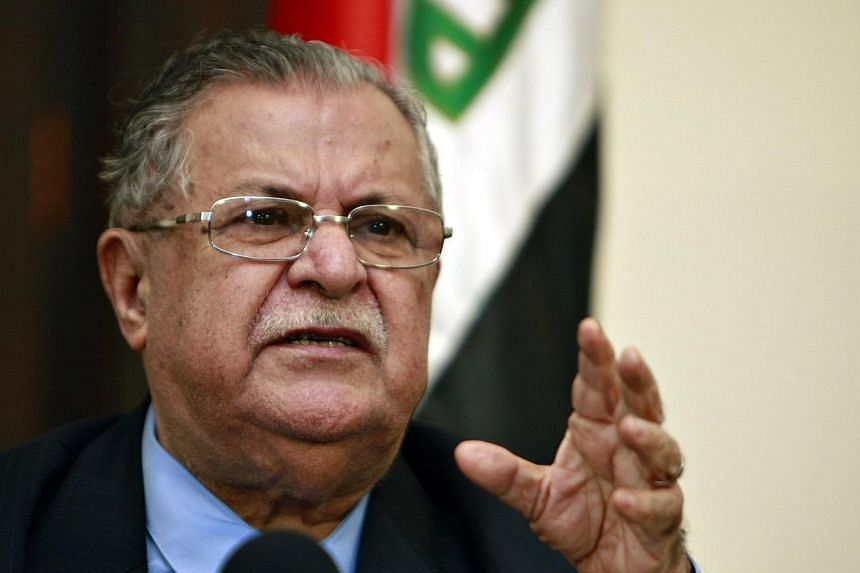 A file picture taken on March 02, 2009, shows Iraqi President Jalal Talabani speaking during a joint press conference in Baghdad. Mr Talabani flew back to his Kurdish fiefdom of Sulaimaniyah on Saturday, July 19, 2014, after more than 18 months in Ge