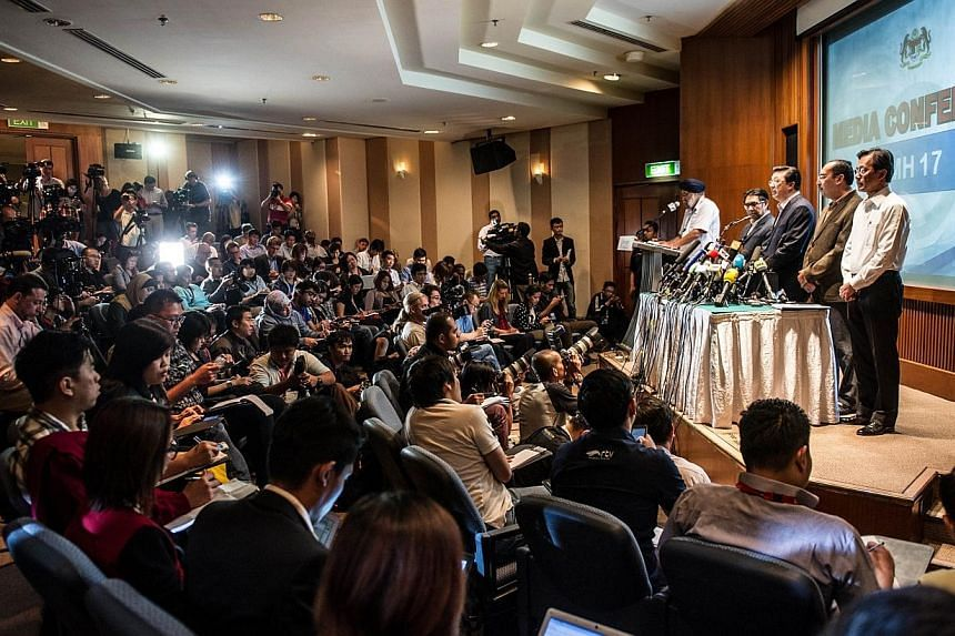 Malaysia's Transport Minister Liow Tiong Lai addresses the media at a hotel near the Kuala Lumpur International Airport in Sepang on July 19, 2014. Malaysia said vital evidence at the Ukrainian site where flight MH17 went down had been tampered with,
