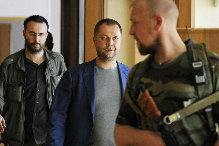 """Self-proclaimed Prime Minister of the pro-Russian separatist """"Donetsk People's Republic"""" Alexander Borodai walks to his press-conference Donetsk on July 18, 2014. -- PHOTO: AFP"""