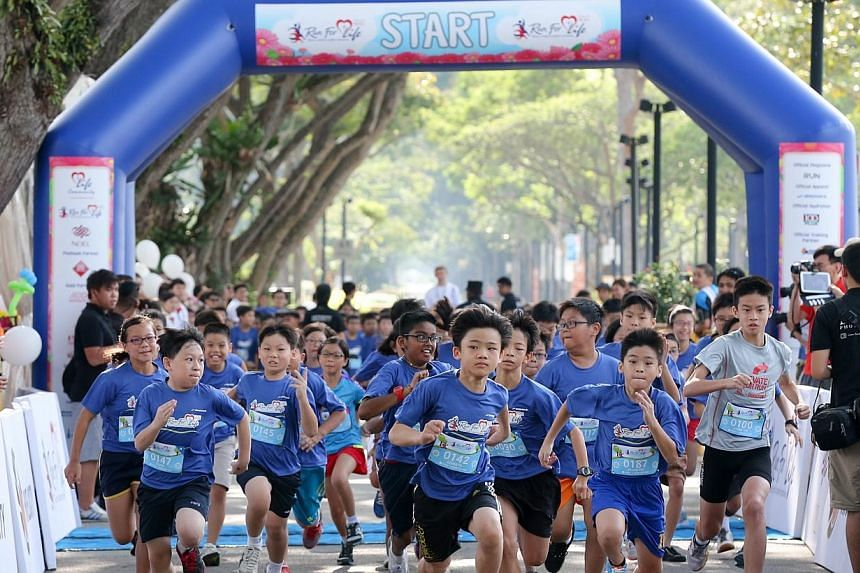 More than 3,600 people ran for a cause on Saturday, July 19, 2014, morning, and raised $600,000 for a charity's programmes which benefit disadvantaged young people. -- ST PHOTO:ONG WEE JIN