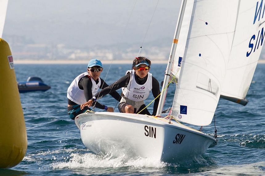 Singapore sailors Loh Jia Yi (left) and Jonathan Yeo were crowned world champions after winning the boys' 420 event at the Isaf Youth Sailing World Championships in Tavira, Portugal.-- PHOTO:NEUZA AIRES PEREIRA/ISAF YOUTH WORLDS
