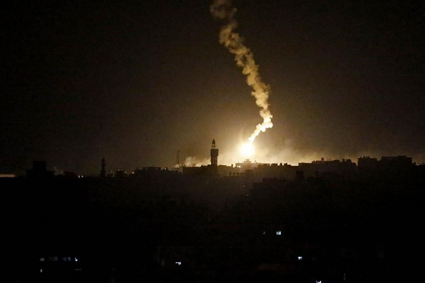 A flare sent by Israeli army illuminates the eastern part of Gaza City on July 18, 2014. Fifty-five Gazans were killed on Friday as Israel pressed a major ground offensive in the coastal enclave, raising the overall Palestinian death toll since July