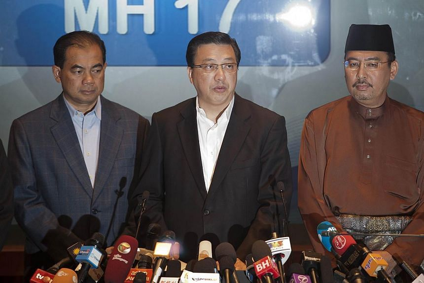 Malaysia's Transport Minister Liow Tiong Lai (centre) addresses the media at a hotel near the Kuala Lumpur International Airport in Sepang on July 18, 2014. Mr Liow will lead a team of medical staff and investigators to the crash site of Malaysia Air
