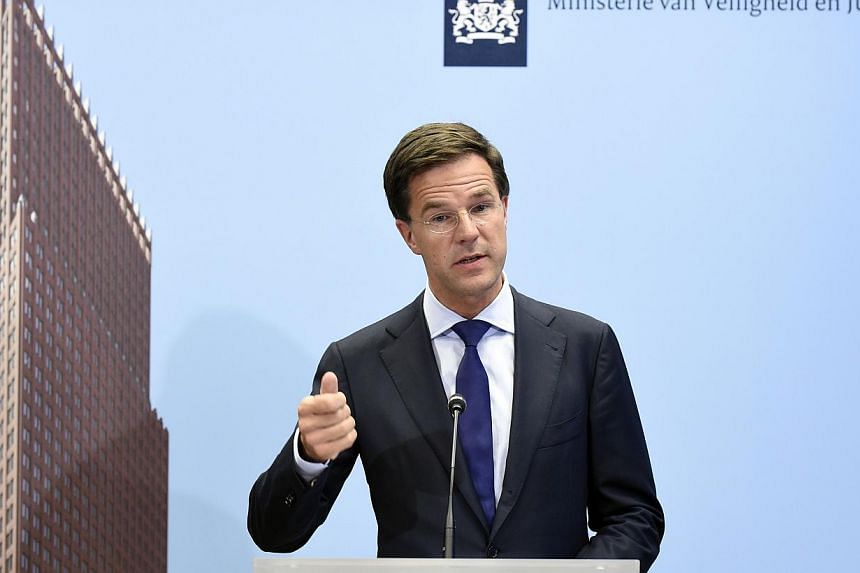 Dutch Prime Minister Mark Rutte speaks during a press conference at the Ministry of Safety and Justice in The Hague, the Netherlands, on July 18, 2014, regarding Malaysia Airlines flight MH17 that crashed on July 17 in eastern Ukraine. -- PHOTO: AFP