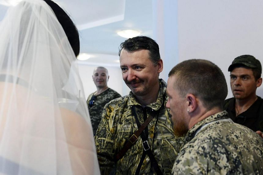 """Commander and self-proclaimed minister of Defence of so the called """"Donetsk People's Republic"""" Igor Girkin, aka Strelok (centre), has claimed that the victims of Malaysia Airlines (MAS) flight MH17 may have already been dead before the plane took off"""