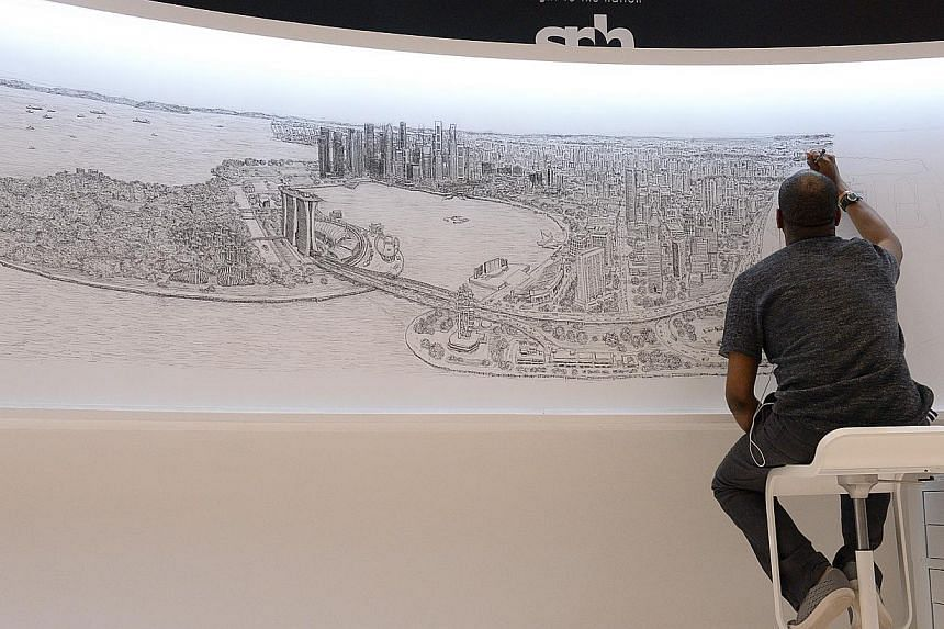 Mr Stephen Wiltshire is into the third day of creating the Singapore skyline on a 4m by 1m canvas at Paragon Shopping mall. His drawing so far includes iconic locations such as Gardens by the Bay.
