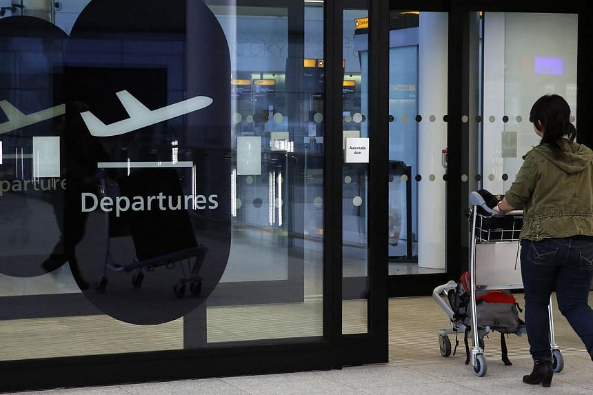 A passenger enters departures in Terminal 2 at Heathrow Airport in London on July 3, 2014. -- PHOTO: REUTERS