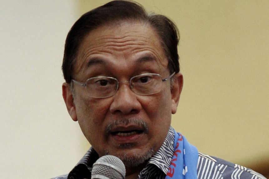 Opposition Leader Anwar Ibrahim has declared his full support for Prime Minister Najib Razak's call for an emergency parliamentary sitting over the MH17 tragedy. -- PHOTO: THE STAR/ASIA NEWS NETWORK