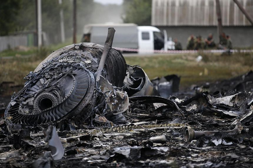 Debris is pictured at the site of Malaysia Airlines Boeing 777 plane crash, near the village of Grabovo in the Donetsk region July 18, 2014. -- PHOTO: REUTERS