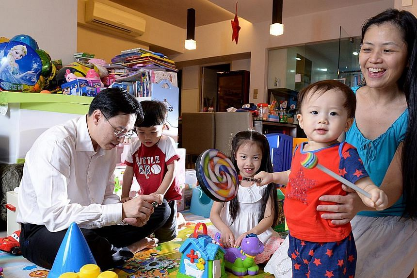 A survey on work-life integration shows differing views of bosses and staff. For example, senior business analyst Esther Wong, seen here with husband Marvin Yeo and their children (from left) Evan, Megan and Galen, was reluctant to request to work fr