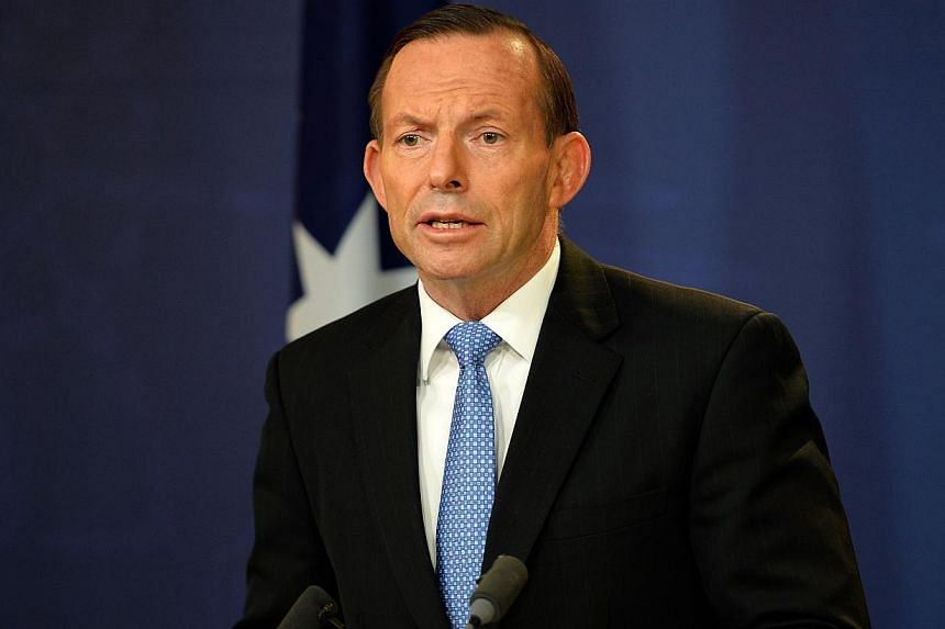Australian Prime Minister Tony Abbott speaks at a press conference in Sydney on July 19, 2014. -- PHOTO: AFP