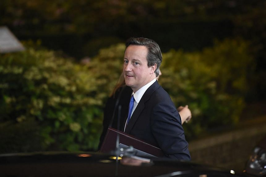 Britain Prime minister David Cameron leaves late on July 17, 2014 after a special meeting of the European Council to discuss further appointments of the bloc's top jobs. British Prime Minister David Cameron raised the prospect on Saturday of fre