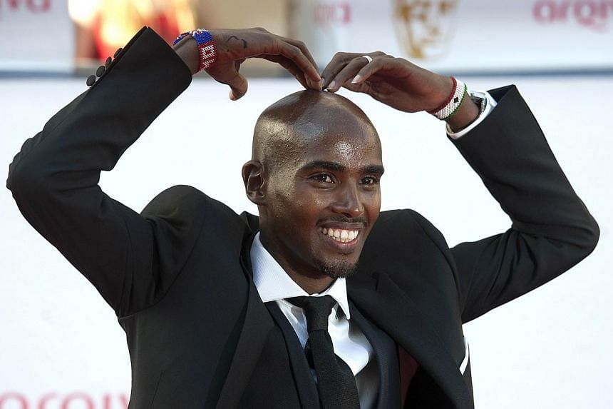 British athlete Mo Farah poses for pictures on the red carpet upon arrival for the BAFTA TV awards in London on May 18, 2014.Olympic champions Usain Bolt, Mo Farah and Bradley Wiggins headline a host of star names hoping to bury injury problems