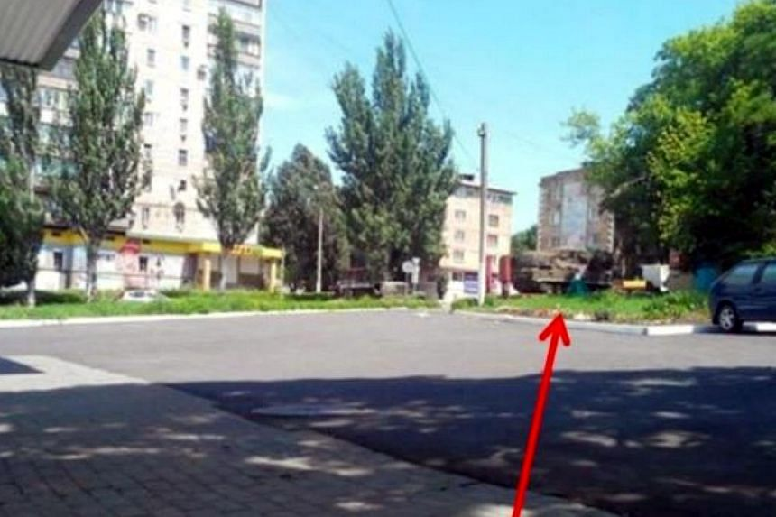 Photo evidence of one of the Russian BUK-M1 surface-to-air missile systems near the town of Snizhne provided by the Ukraine crisis media centre. -- PHOTO: THE STAR/ASIA NEWS NETWORK