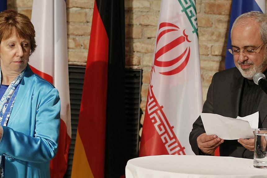 EU foreign policy chief Catherine Ashton and Iranian Foreign Minister Mohammad Javad Zarif attend a news conference in Vienna on July 18, 2014. Iran faced Western pressure on Saturday to make concessions over its atomic activities after it