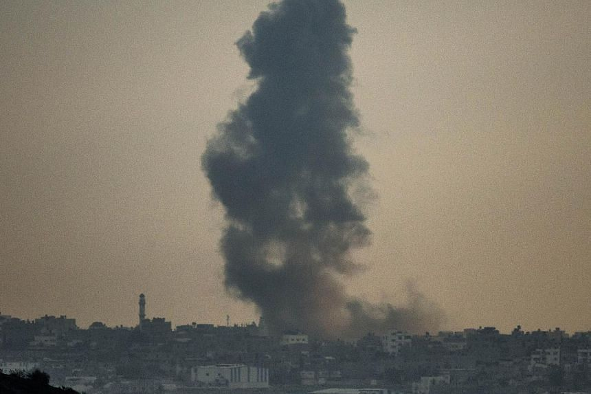 A picture taken on July 19, 2014 from the southern Israeli-Gaza border shows smoke billowing from buildings following an Israeli air strike on Gaza City.Israel's Government Press Office on Saturday warned foreign journalists it was not responsi