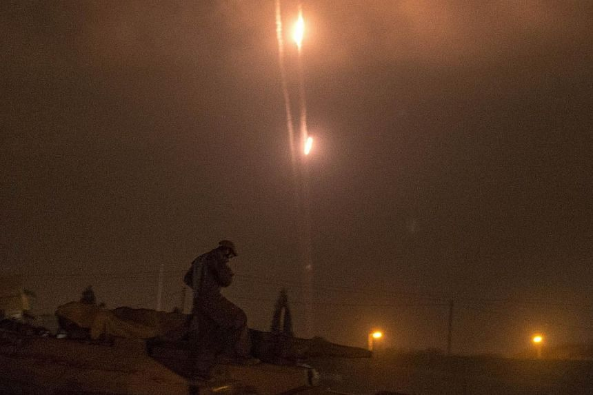 A picture taken from the southern Israeli-Gaza border shows rockets being fired from the Gaza Strip into Israel, on July 19, 2014.Israel fired shells into the Gaza Strip and militants kept up rocket fire into the Jewish state on Sunday with no