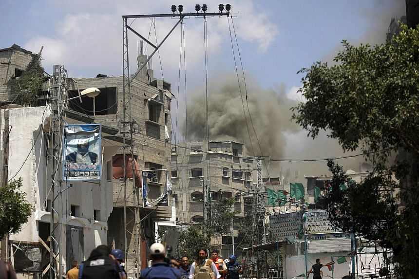 Smoke rises during the ongoing Israeli military offensive on the Shejaiya neighborhood between Gaza City and the Israeli border on July 20, 2014.More than 60 Palestinians were killed Sunday as Israeli forces pounded northern Gaza, sending thous