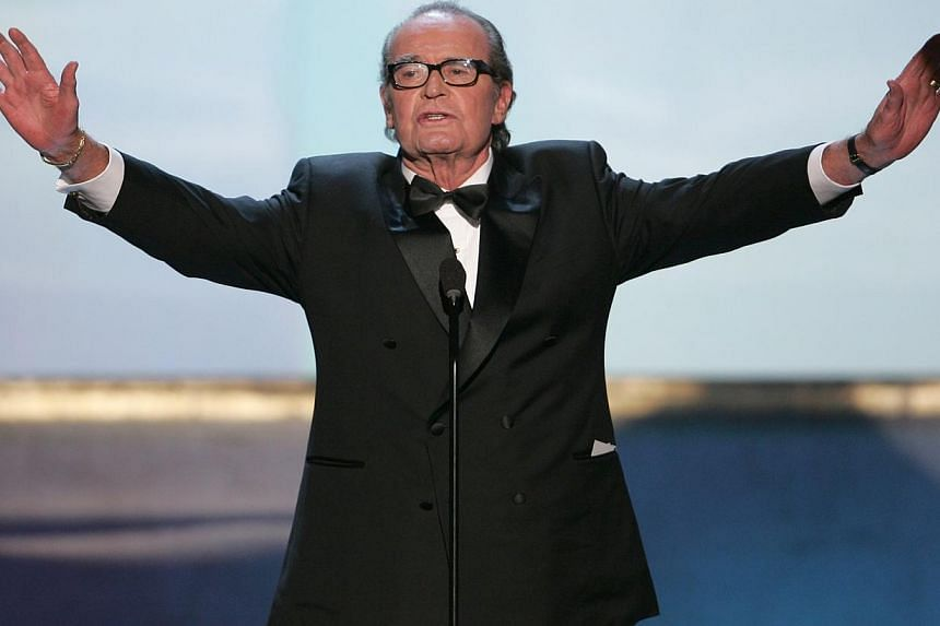 Actor James Garner holds out his arms at the 11th annual Screen Actors Guild awards at the Shrine Auditorium in Los Angeles on February 5, 2005.Actor James Garner, best known for his prime-time television roles as the wisecracking frontier gamb