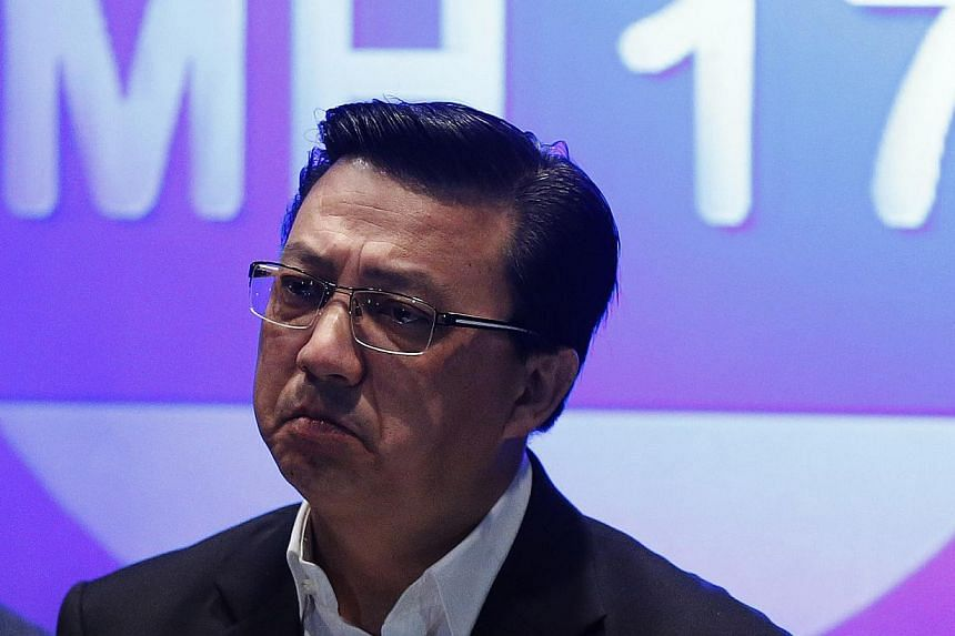 Malaysia Transport Minister Liow Tiong Lai arrived in Kiev on Sunday, July 20, 2014, with a six-member delegation assist the Malaysian team in a special operation on the MAS flight MH17 crash in east Ukraine on Thursday, July 17, 2014. -- PHOTO: REUT