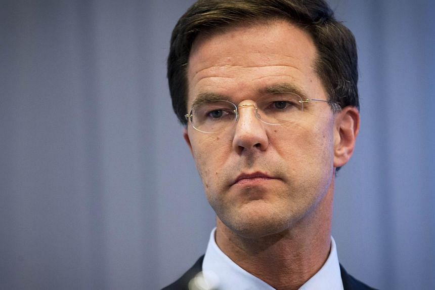 Dutch Prime Minister Mark Rutte gives a press conference at the Ministry of Safety and Justice in The Hague, on July 18, 2014, a day after an aircraft of Malaysia Airlines crashed in eastern Ukraine. Mr Rutte said on July 19, 2014, thatVladimir