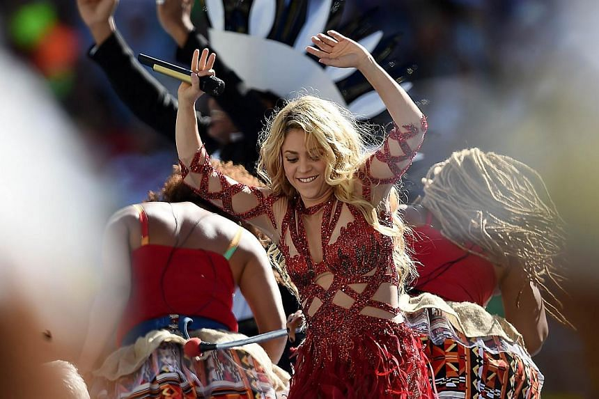 Colombian singer Shakira performs during a closing ceremony ahead of the final football match between Germany and Argentina for the FIFA World Cup at The Maracana Stadium in Rio de Janeiro on July 13, 2014. Shakira has become the first person to