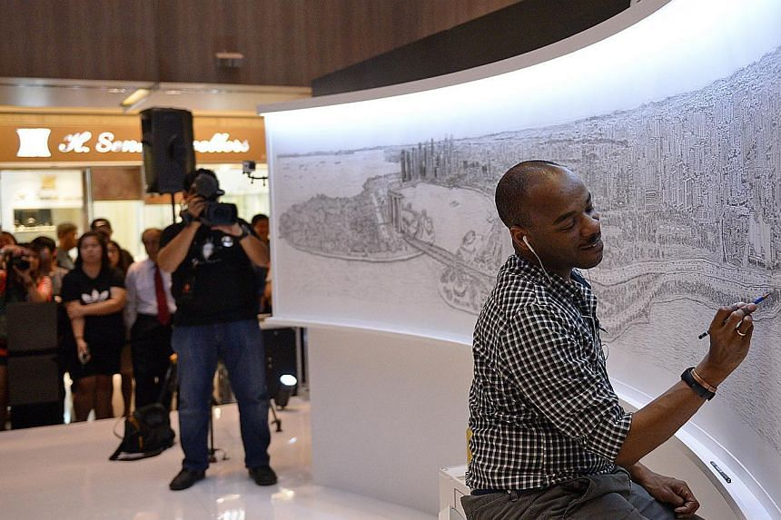 British architectural artist Stephen Wiltshire adding the finishing touches to his panorama of Singapore after five days of drawing.-- ST PHOTO:DESMOND WEE
