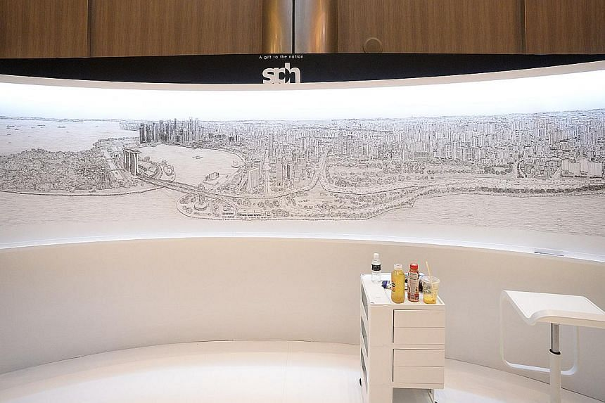 The completed panorama, which was drawn on a 4m by 1m canvas by British architectural artist Stephen Wiltshire. -- ST PHOTO: DESMOND WEE