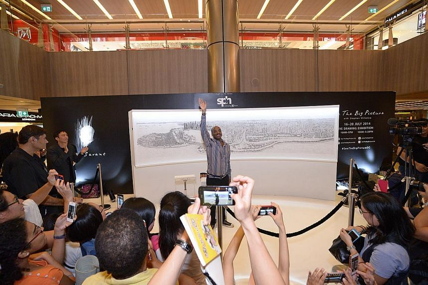 British architectural artist Stephen Wiltshire waves to the crowd after completing his panorama of the Singapore cityscape. -- ST PHOTO: DESMOND WEE