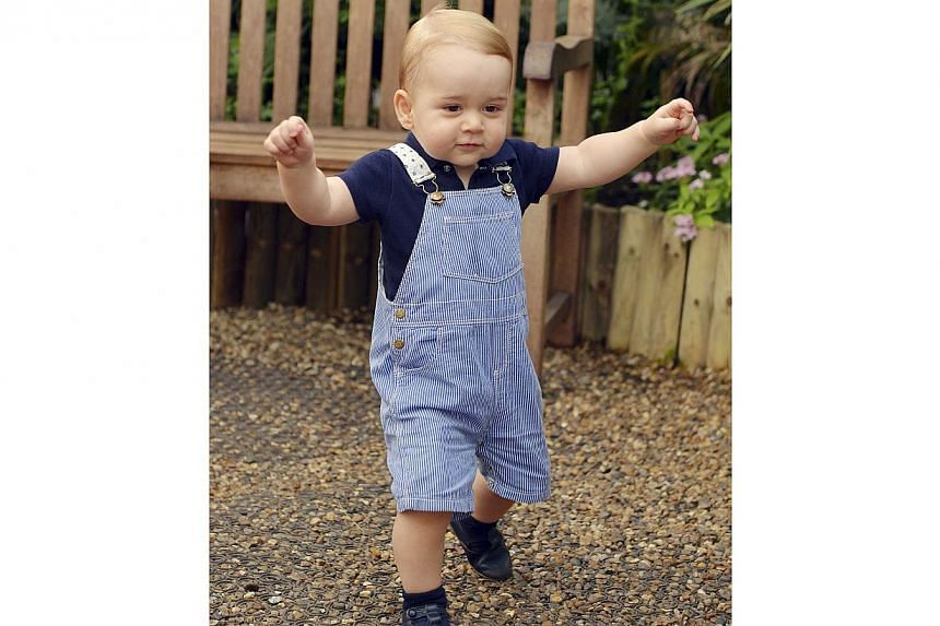 Britain's Prince George is seen ahead of his first birthday during a visit to the Sensational Butterflies exhibition at the Natural History Museum in London on July 2, 2014. -- PHOTO: REUTERS