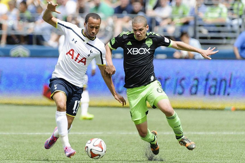 Tottenham Hotspur midfielder Andros Townsend (left) and Seattle Sounders FC midfielder Osvaldo Alonso fight for the ball during the first half at CenturyLink Field. -- PHOTO: REUTERS