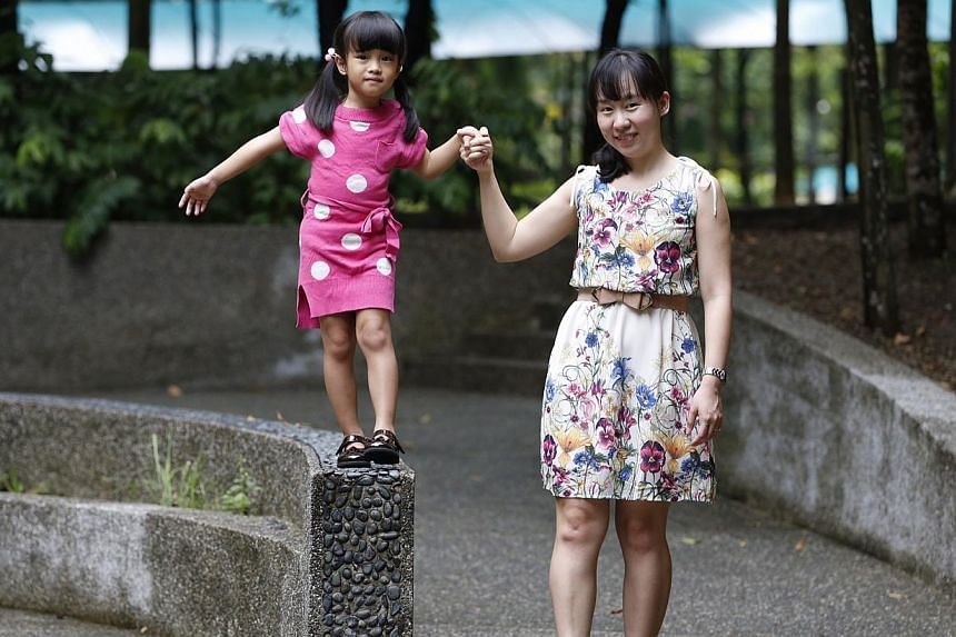 Ms Serene Lee, 34, with her daughter Chloe, four. A recent survey found that although staggered start and end times were the top-ranked benefit among working mums with young children, less than a quarter used the scheme.