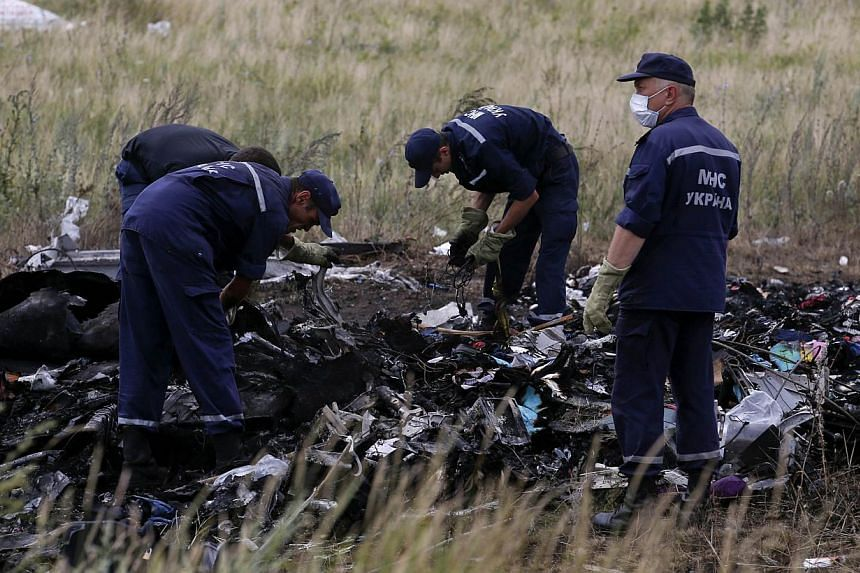 Ukrainian emergency workers at the site of the crashed MAS plane in the Donetsk region. After each crash, disaster or terrorist episode, it is natural to point fingers but the truth is that air transportation, like most other modern systems, could no